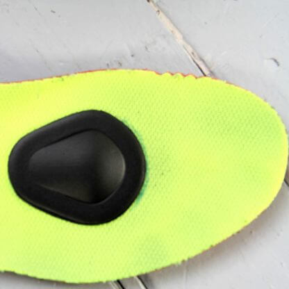 Pad on shoe insert