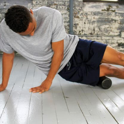 Travel Size Extra Firm Foam Roller in use